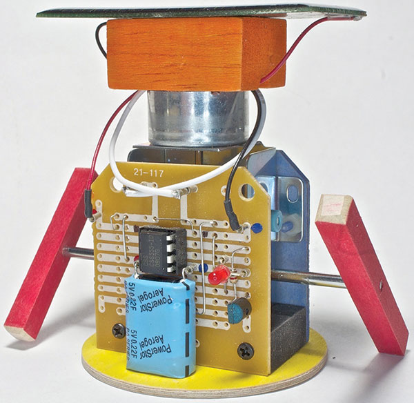 """the remarkable css555 nuts volts magazine for the """"walker the robot """" he is energized by the solar cell on his head"""